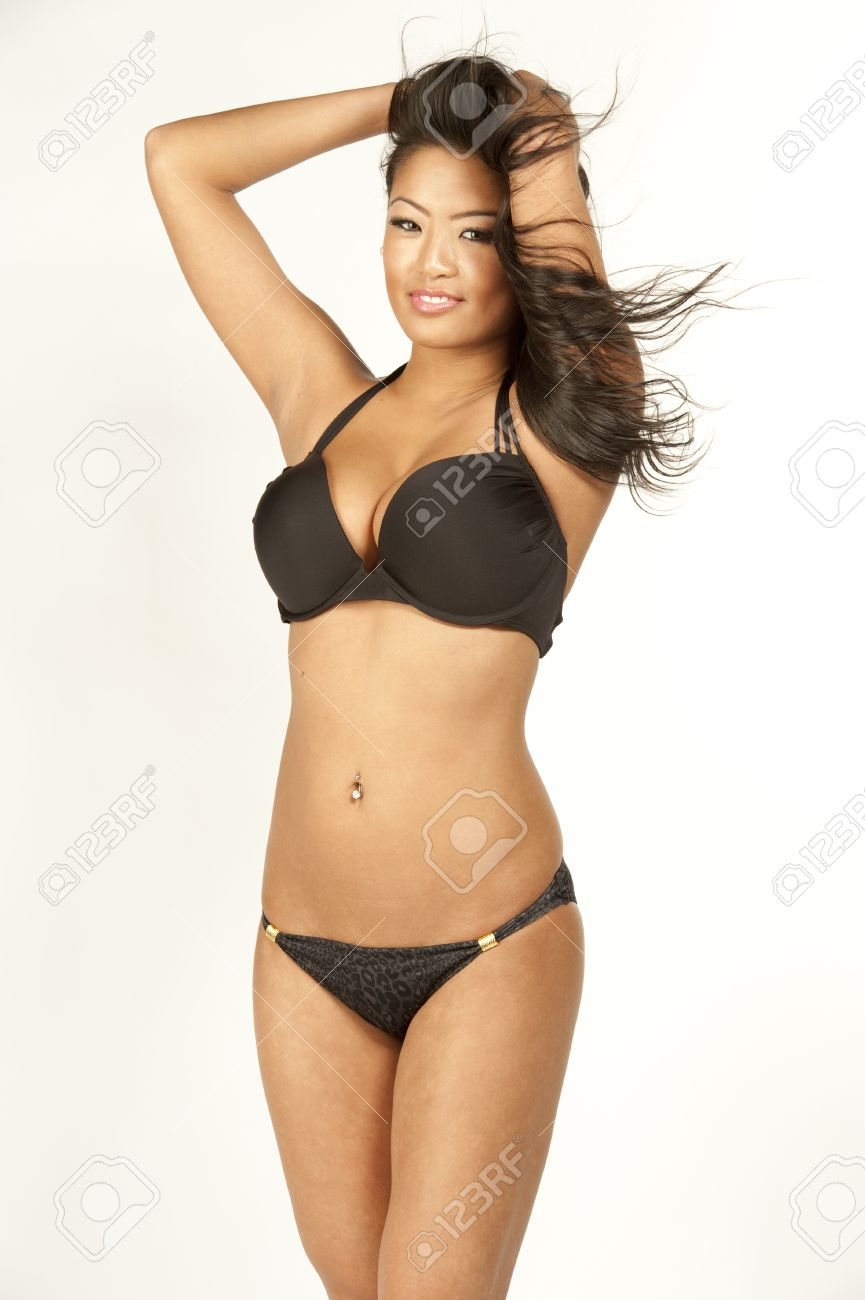 a3447385d5cbed A beautiful asian swimsuit model smiling wearing a black 2 piece swimsuit  on a white background