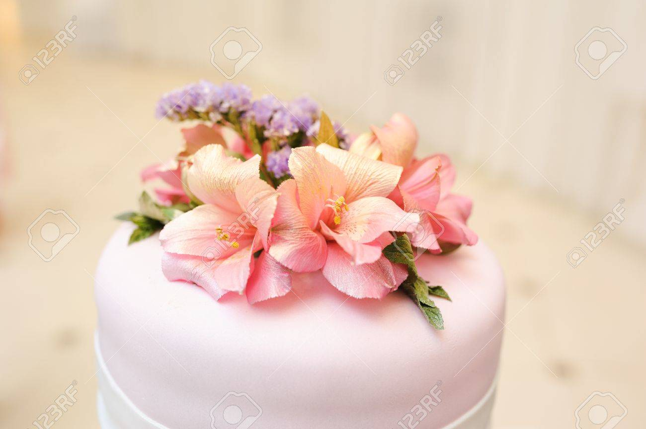 Wedding Cake Decorated With Pink Lily Flowers Stock Photo Picture