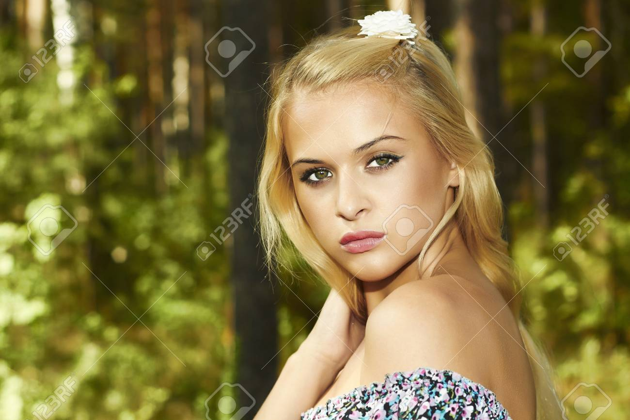 Beautiful blond woman in forest white flower in hair stock photo beautiful blond woman in forest white flower in hair stock photo 21356627 mightylinksfo