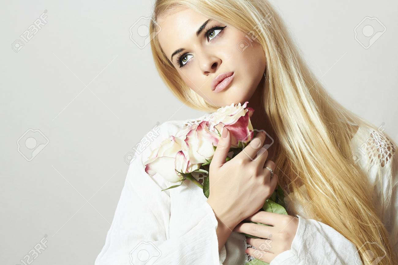 Beautiful Blond Woman With Roseswhite Flowerrl Holding A Stock