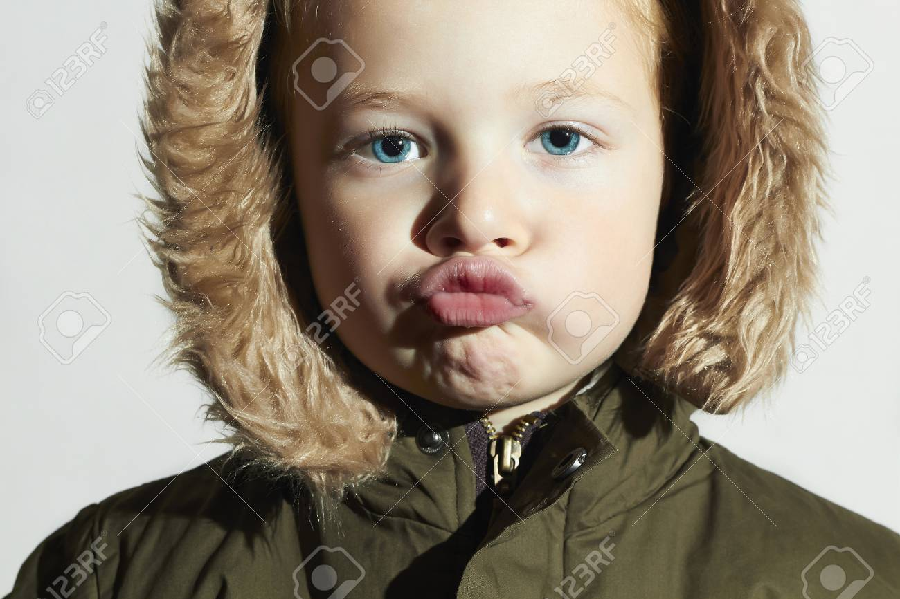 fe20c4d3310f Funny Child In Fur Hood And Winter Jacket. Fashion Kids.children ...