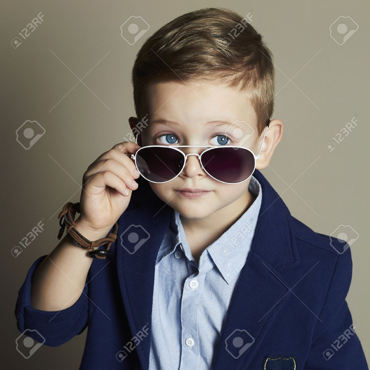 a9b67e551ec fashionable little boy in sunglasses.stylish kid in suit. fashion children.business  boy