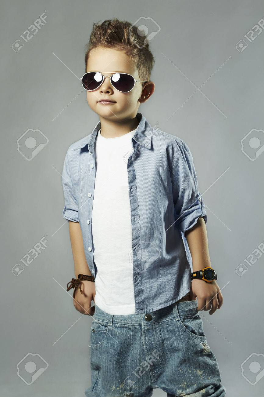 84f5fb9c4c85 fashionable little boy in sunglasses.stylish kid in jeans. fashion children  Stock Photo -