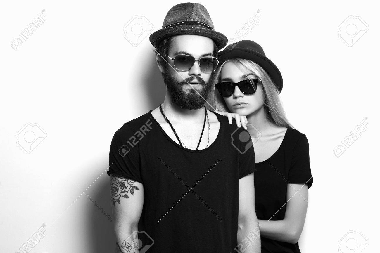 333e1ca7bee beautiful happy couple in hat. Hipster boy and girl. Bearded young man and  blonde