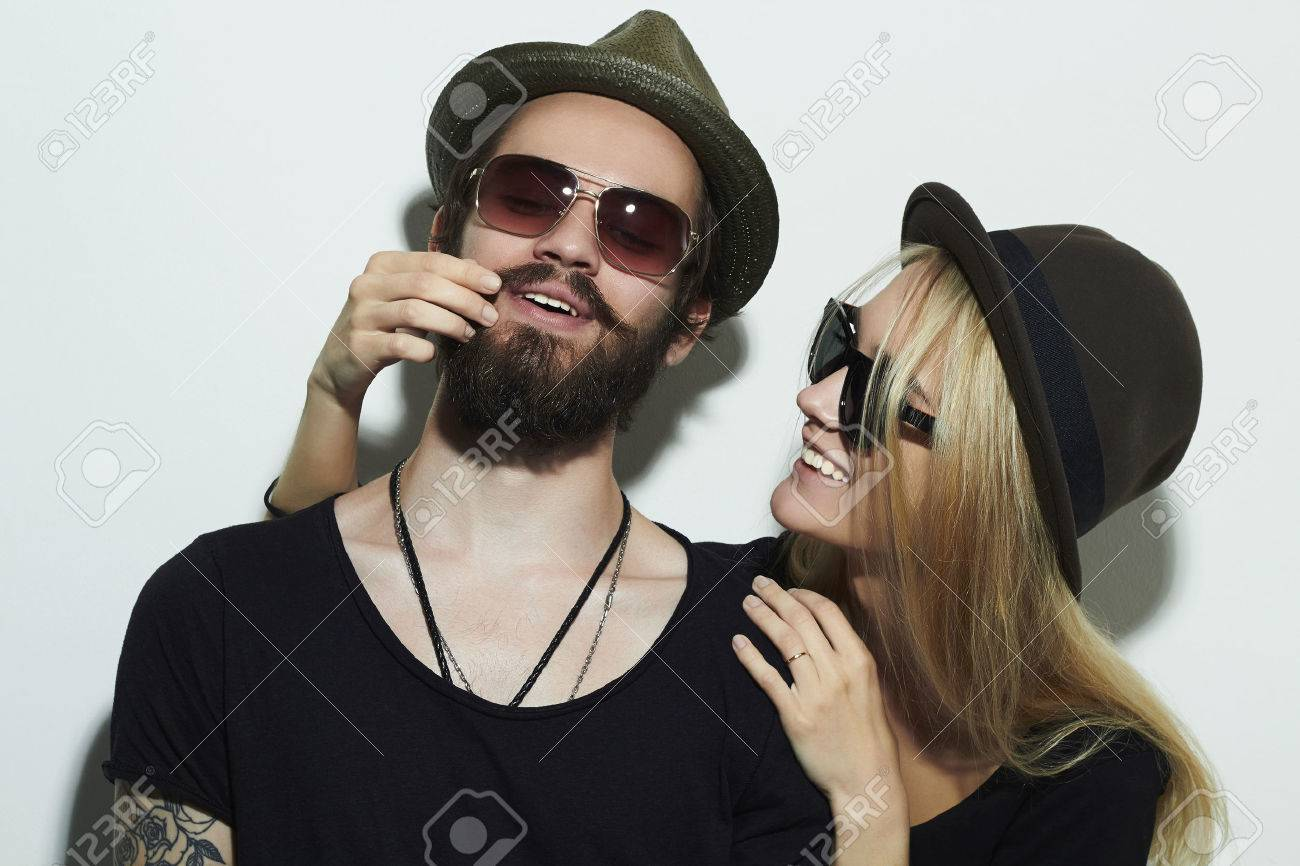 13171b19635 fashion beautiful happy couple in hat wearing trendy glasses together.  Hipster boy and girl.