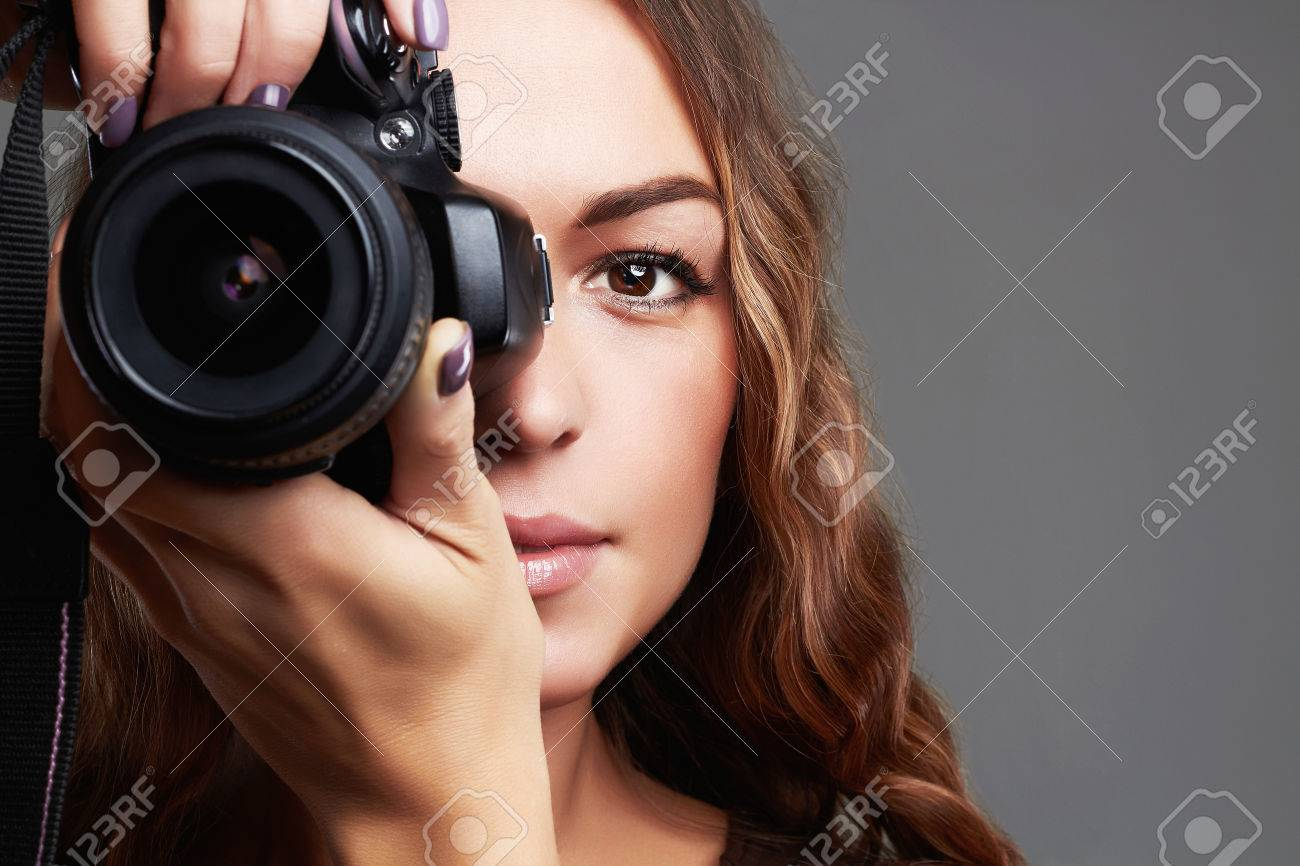 Beautiful girl with camera pretty woman is a professional photographer stock photo 75332064