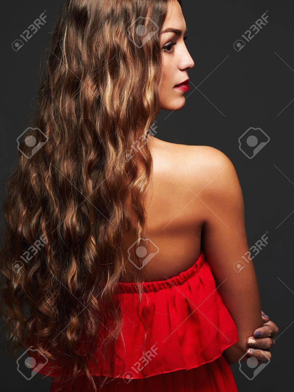 Back View Of Brunette Woman With Long Curly Hair Beautiful Girl