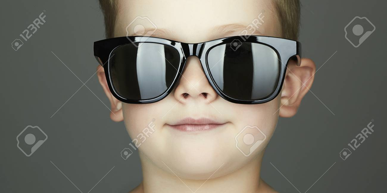 9b36c767abf9 smiling child boy in sunglasses. handsome funny kid close-up portrait Stock  Photo -