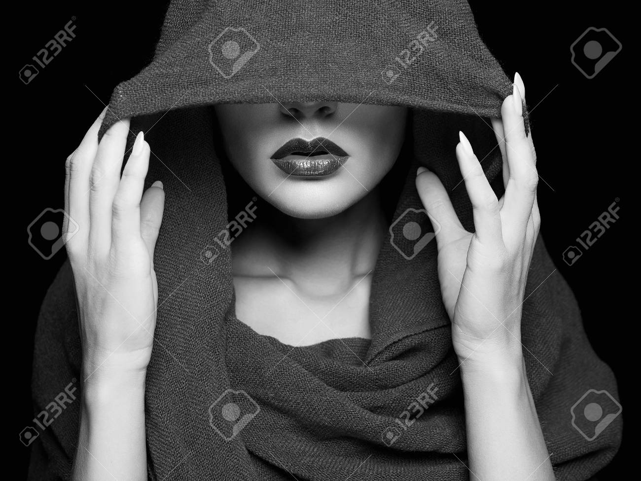 beautiful woman covers her face with scarf.beauty girl in hood Stock Photo  - 86740004 3fb74d8b6a96