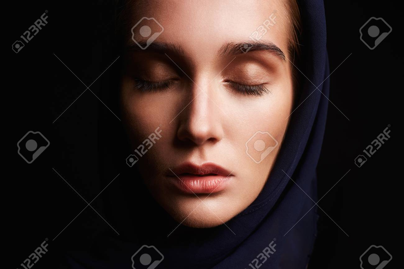 84e75afda8b beautiful girl with head covering. religious young woman.beauty girl in hood  Stock Photo