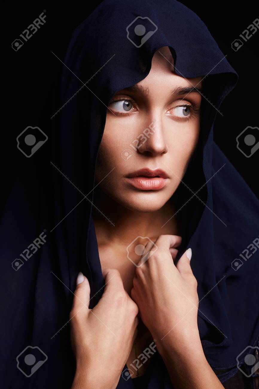 praying beautiful girl with head covering  religious young woman