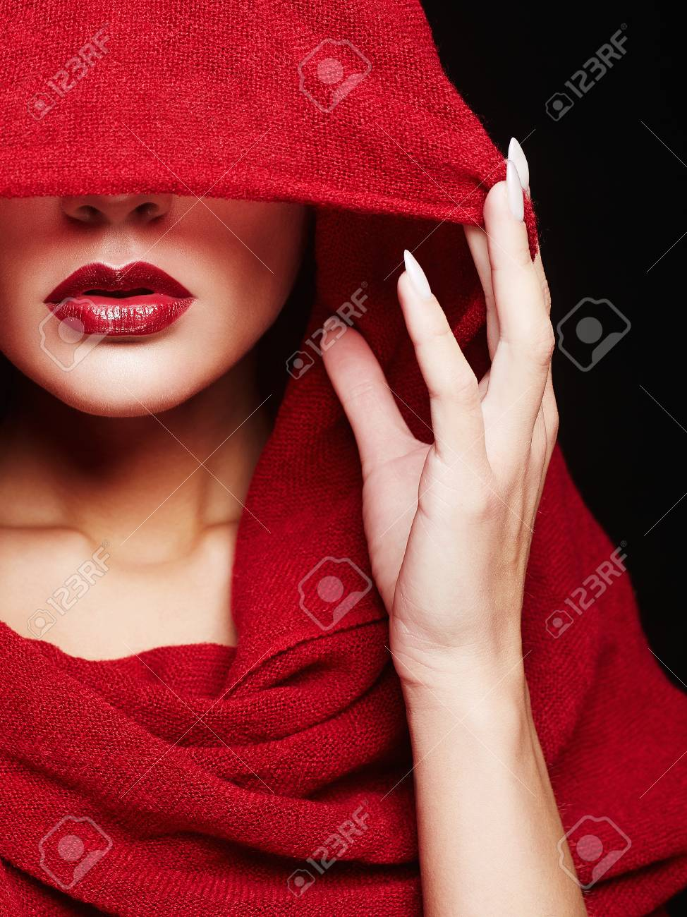 beautiful woman covers her face with a colored hood.red lips make-up girl 74160ef6c9e5