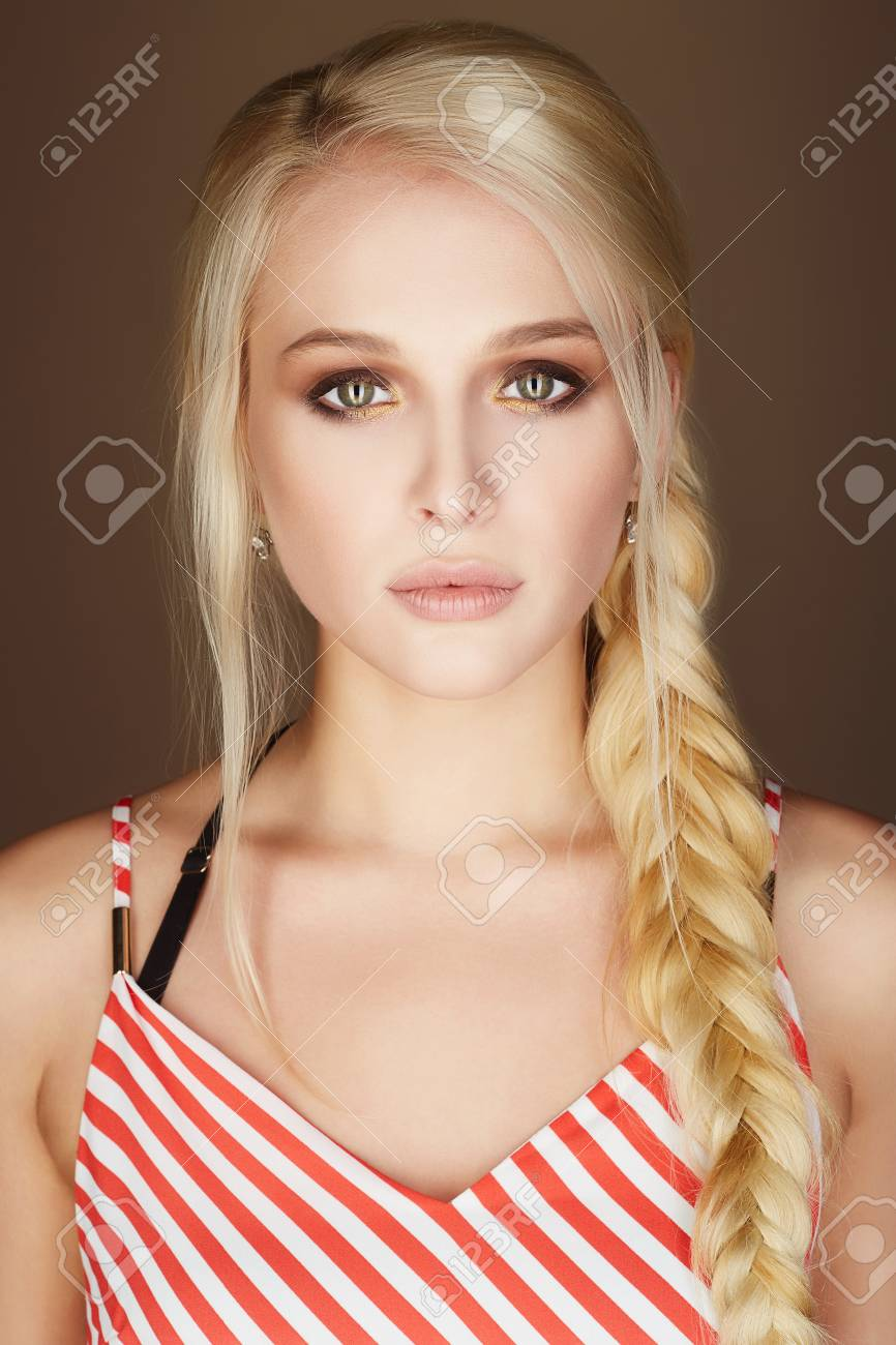 fa0f6f087 beautiful blonde young woman. braided hair. beauty fashion portrait. blond sexy  girl Stock