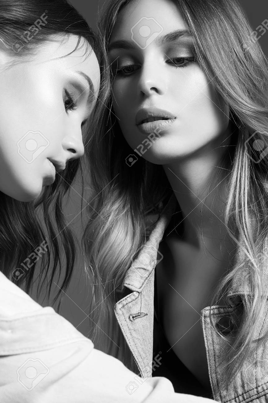 Hug of two women black and white photo stock photo