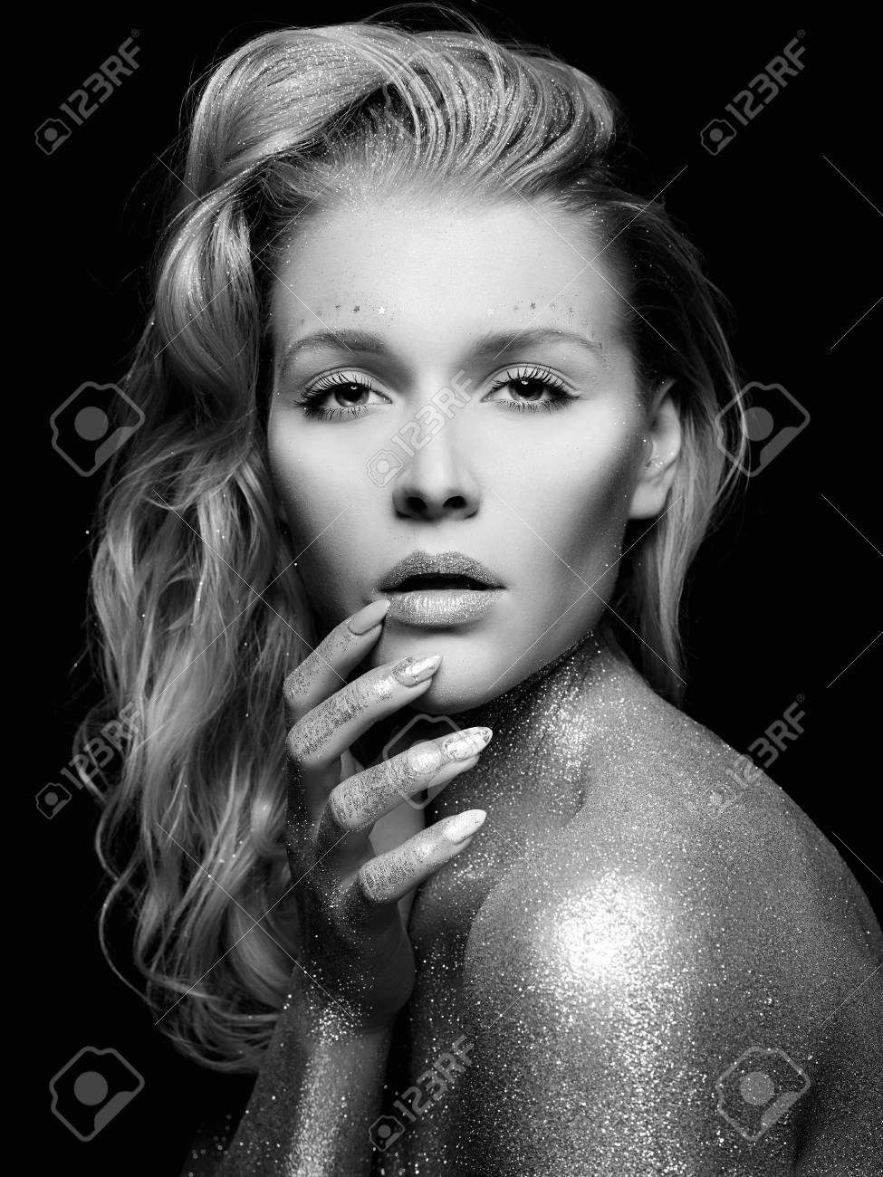 Black and white beauty portrait of beautiful young woman with sparkles girl