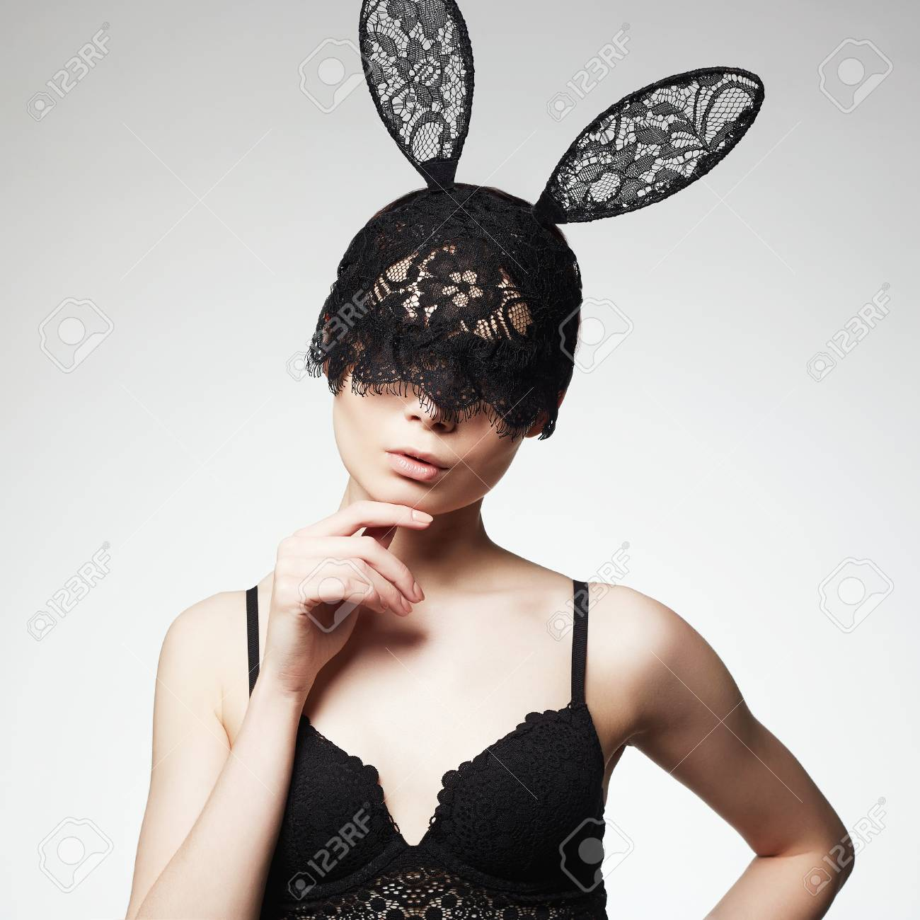 Beautiful Sexy Girl in Lace Mask. Young Woman in lingerie and funny Bunny  Ears mask