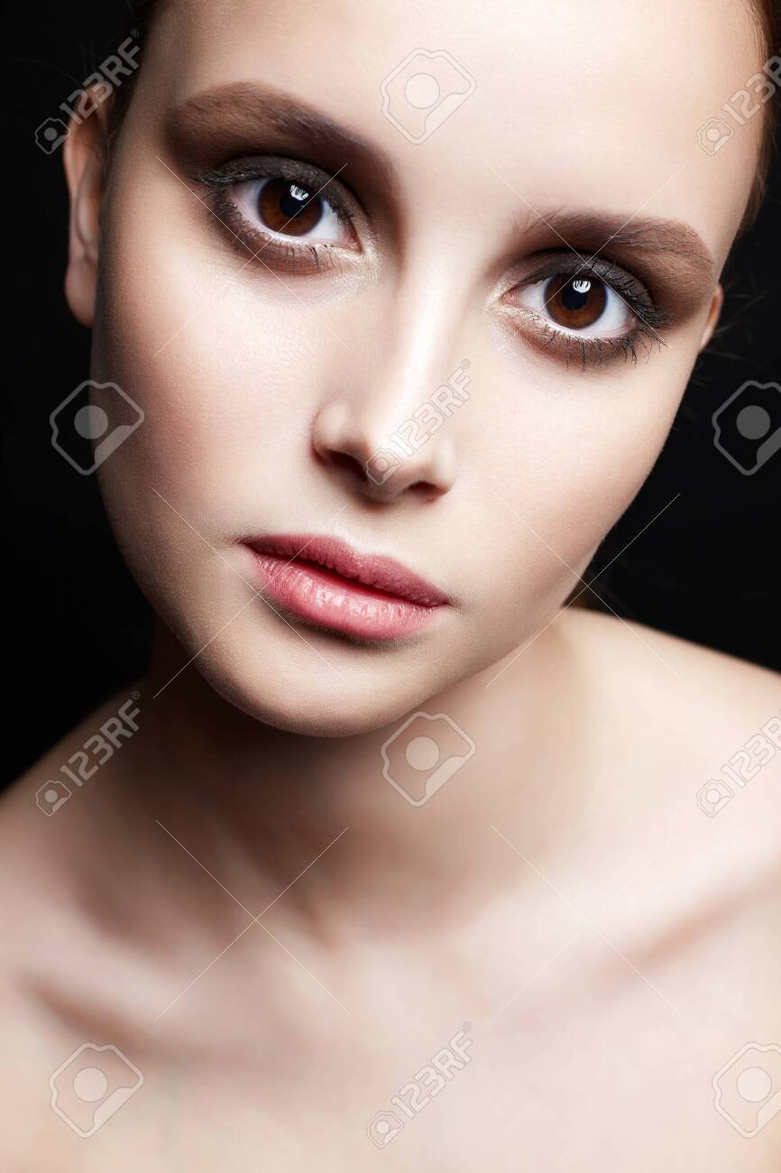 beautiful girl with big brown eyes. young woman with clean skin face. Beauty Fashion Portrait - 129149026