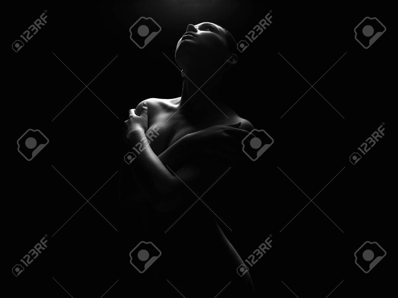 Black nude woman silhouette Nude Woman Silhouette Under Light In The Dark Beautiful Sexy Stock Photo Picture And Royalty Free Image Image 146540005