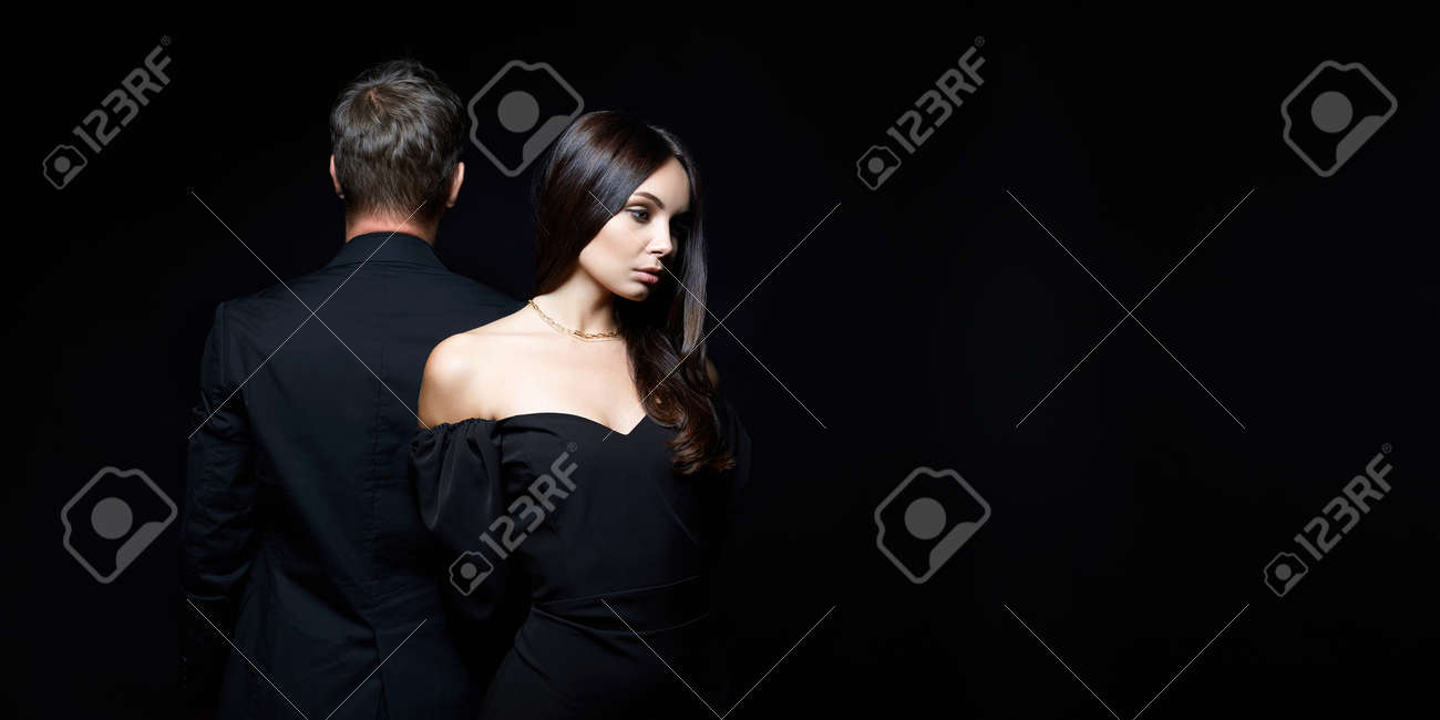 beautiful woman together with a man in a suit. Relationship concept photo. Couple treason - 164624136