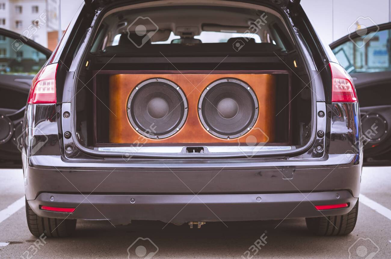 Car Audio System >> Rear View Of A Car Trunk And Front Doors Opened With Installed