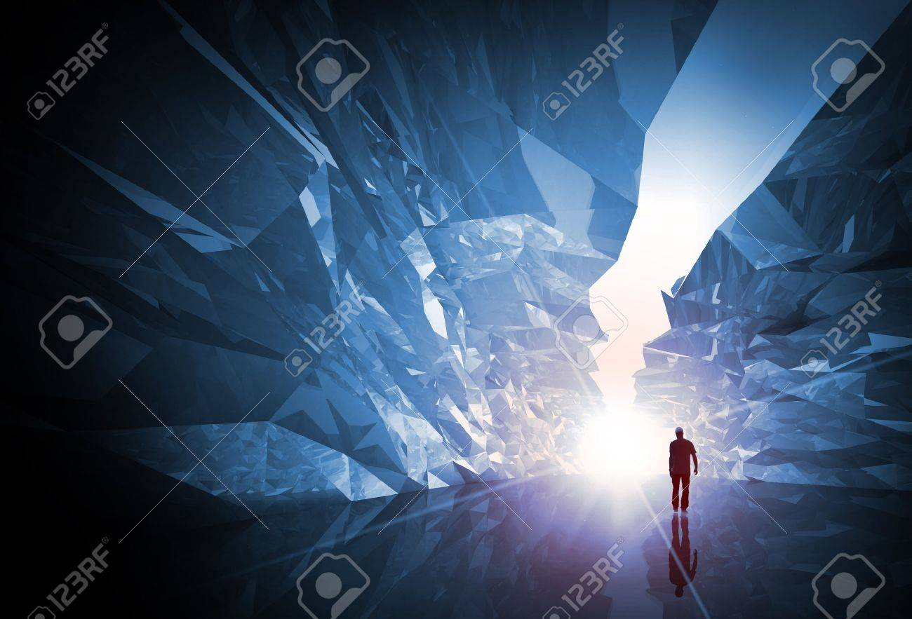 Man walks through the fantasy crystal corridor with rugged walls and bright glowing end Stock Photo - 15546320
