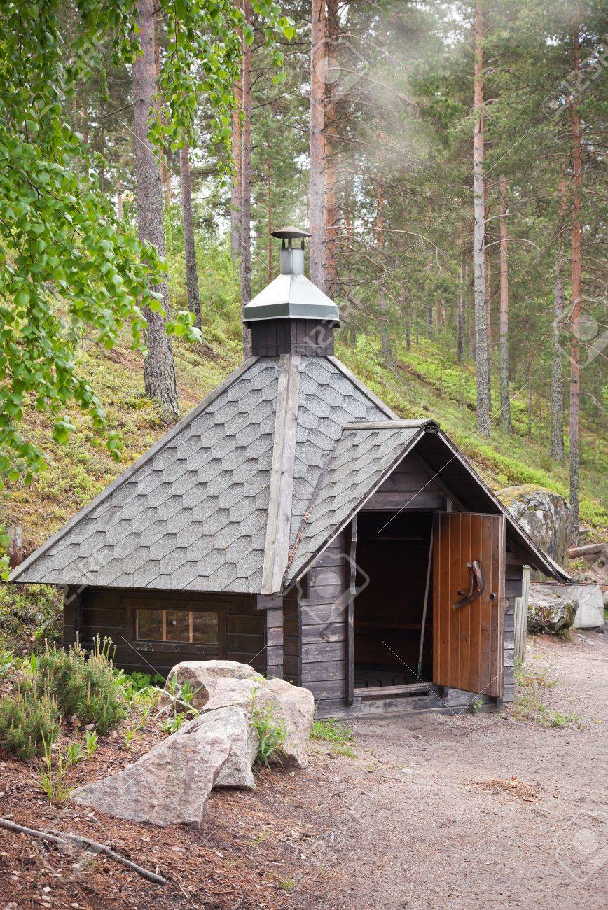 Small wooden free for use cosy grill house in the forest imatra finland stock photo