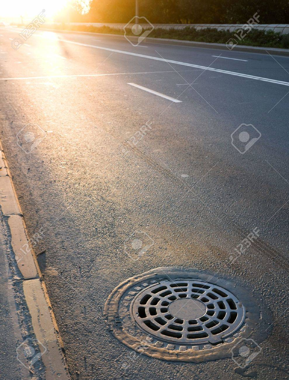 Sewer manhole cover on the roadside Stock Photo - 15658748