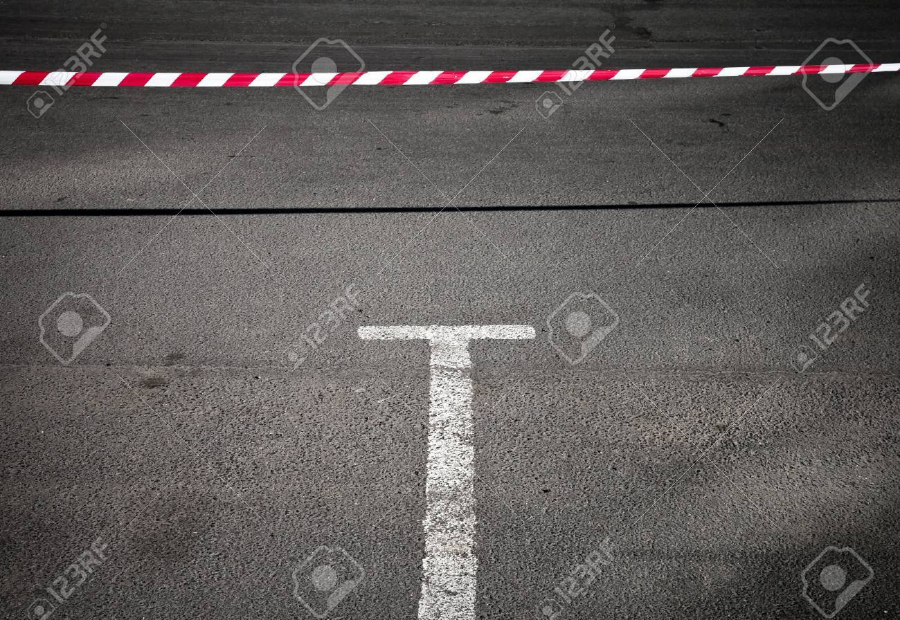 Abstract minimal background with empty parking place and prohibiting red and white striped tape Stock Photo - 15658737