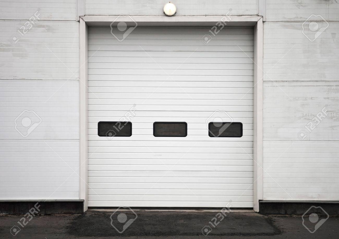 Texture of modern storage building wall with closed gate Stock Photo - 15742044
