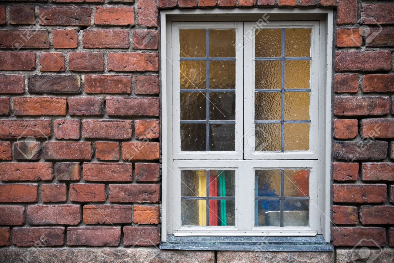 Background texture of old red brick wall with window Stock Photo - 15840965
