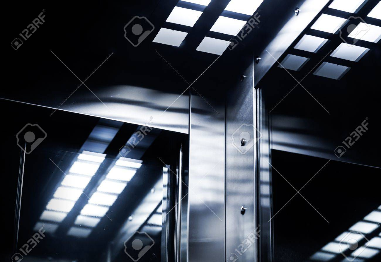 Abstract modern dark interior fragment with shining steel and mirrored glass Stock Photo - 16307679