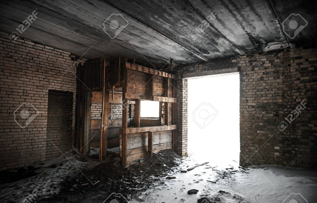 Old Grunge Abandoned Barn Interior With Glowing Exit Stock Photo