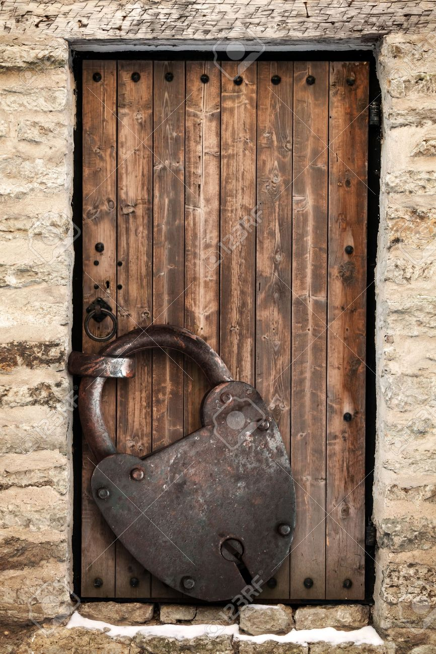 Ancient locked wooden door and big rusted padlock old fashioned safety concept Stock Photo - & Ancient Locked Wooden Door And Big Rusted Padlock Old Fashioned ...