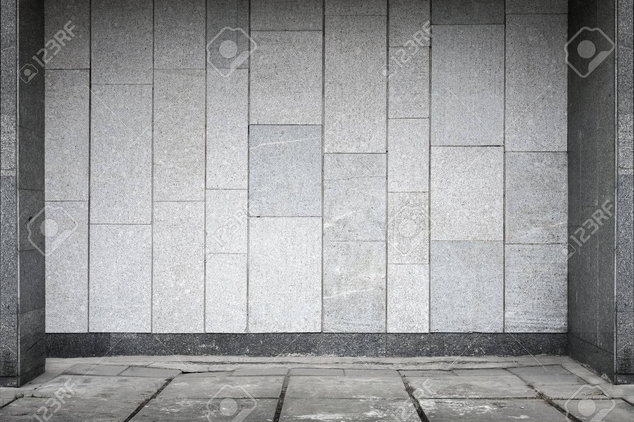 Empty urban interior with stone tiling on wall and concrete floor empty urban interior with stone tiling on wall and concrete floor pavement stock photo 26543032 dailygadgetfo Choice Image