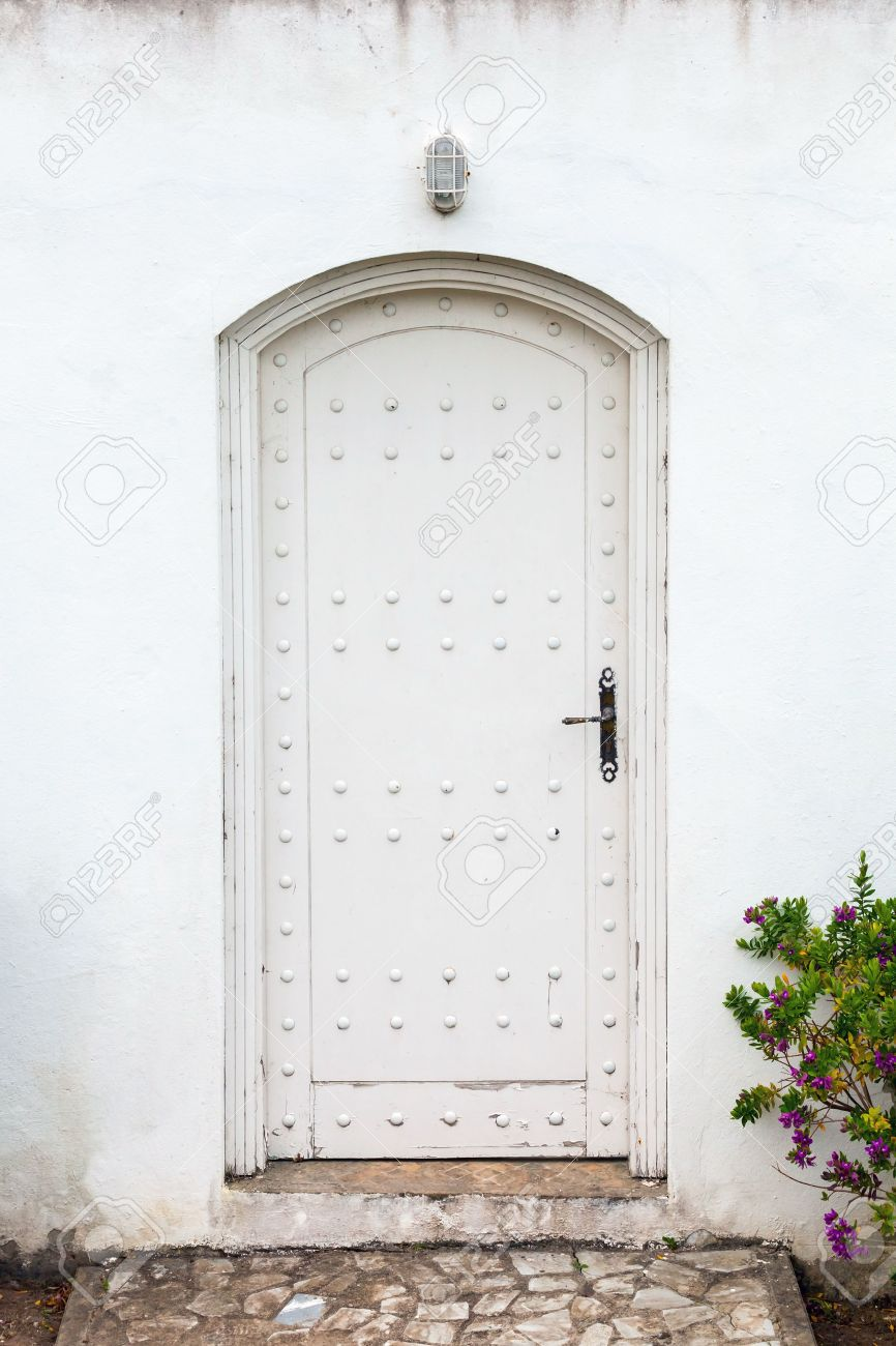 White Wood Door Texture white wall and old wooden door background texture stock photo