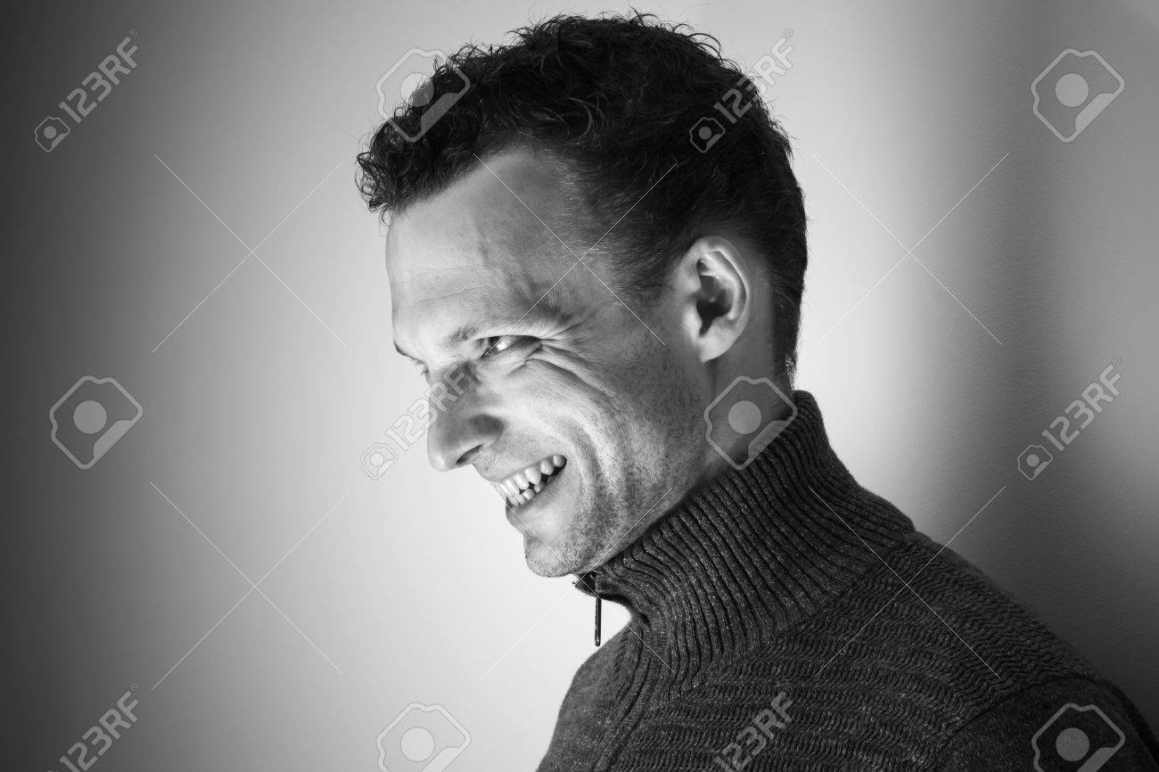 Angry Laughing Young Caucasian Man Black And White Portrait Stock