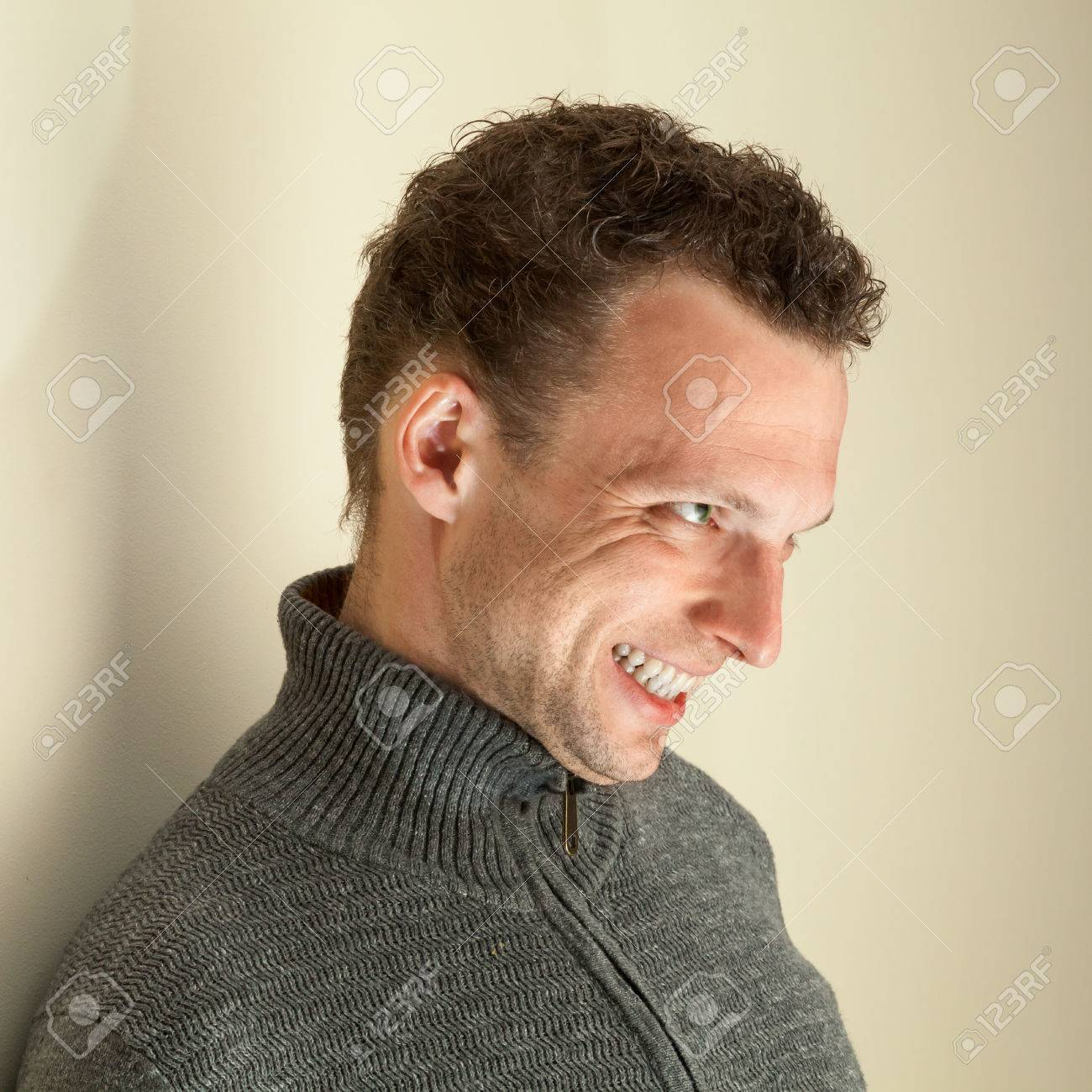 Angry Laughing Young Caucasian Man Closeup Portrait Stock Photo