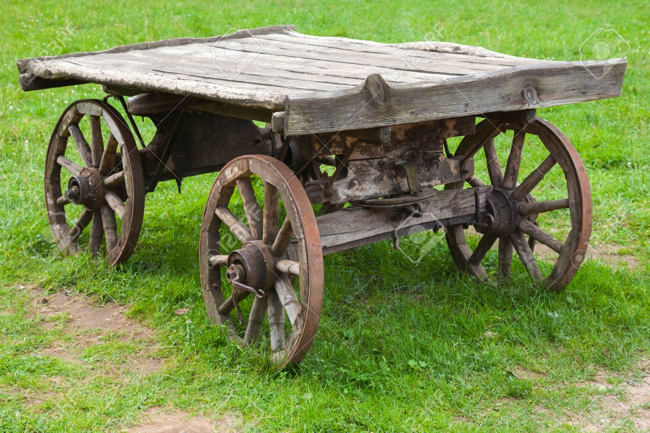 Empty Old Rural Wooden Wagon Stands On Green Summer Grass Stock Photo,  Picture And Royalty Free Image. Image 30361694.