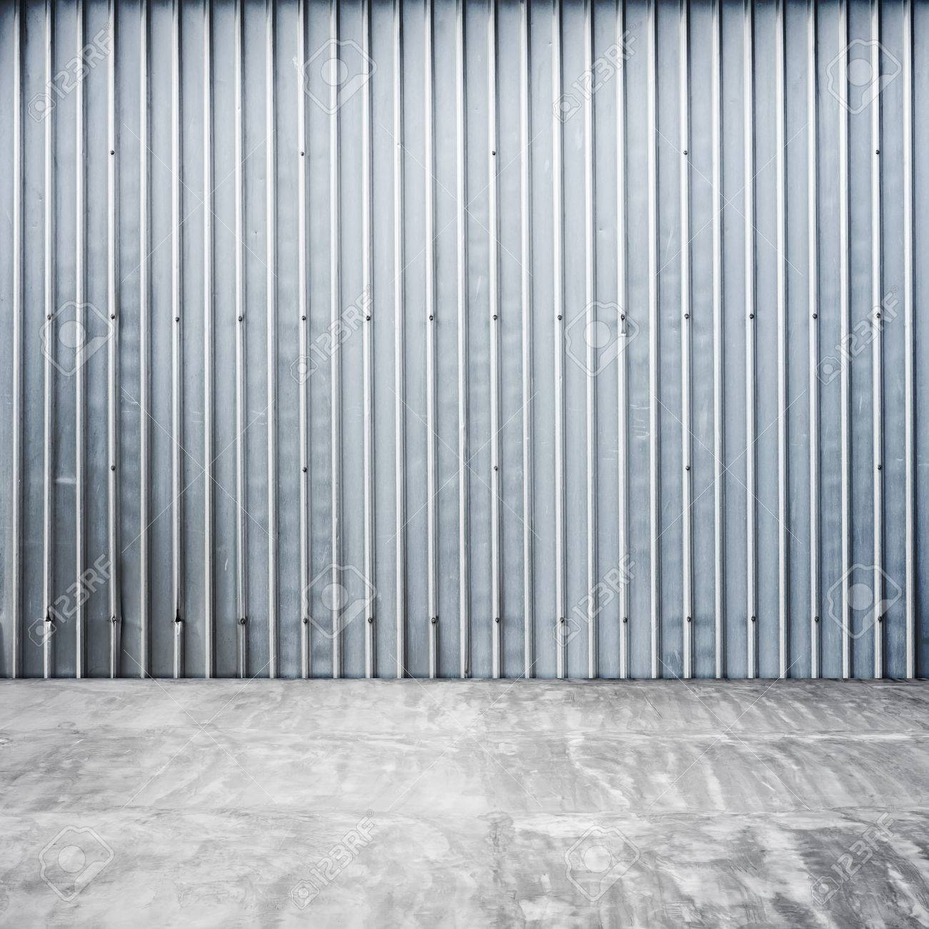 Empty Garage Inside Abstract Interior With Ridged Metal Wall And Concrete Floor Stock