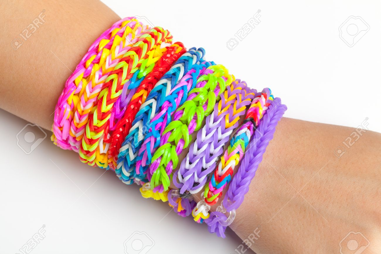 Colorful Rubber Rainbow Loom Band Bracelets On Hand, Trendy Kids Fashion  Accessories Stock Photo