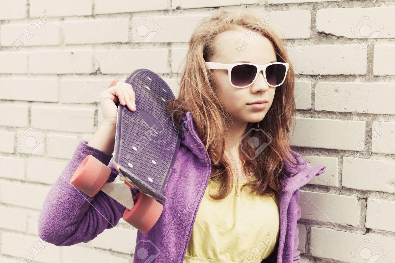 Blond Teenage Girl In Sunglass...