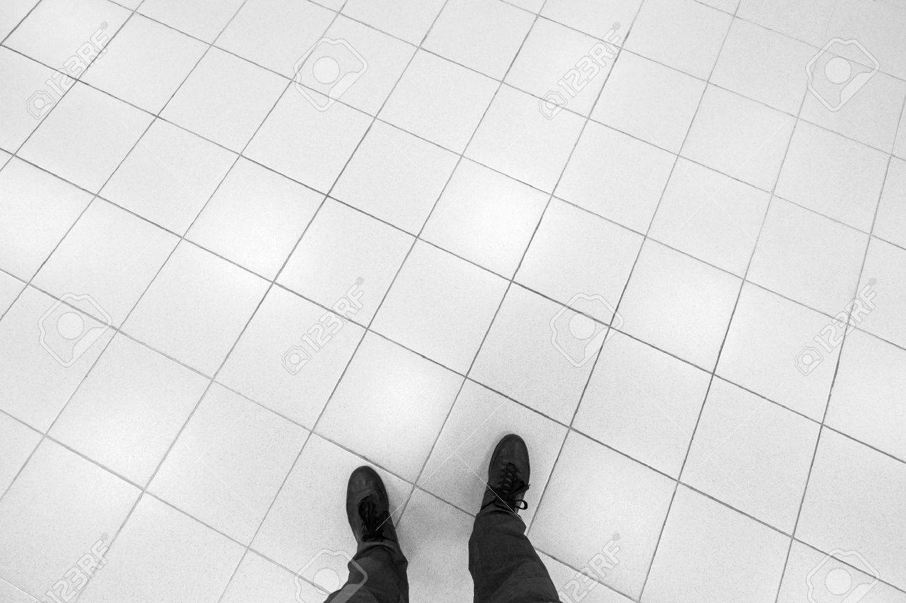 Floor tiles stock photos royalty free business images male feet stand on office floor with white shining square tiling dailygadgetfo Gallery