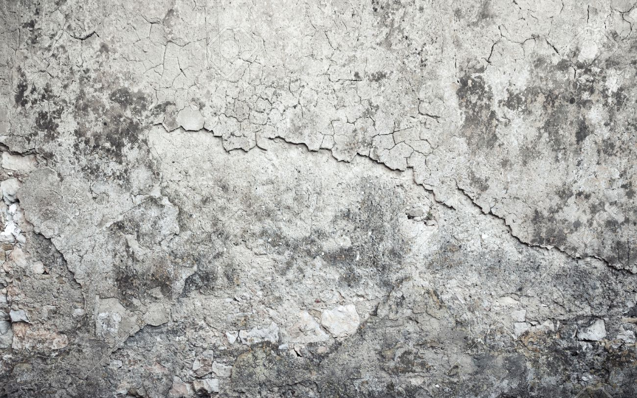 Old weathered concrete wall with damages and cracks on gray stucco, background texture - 44563550