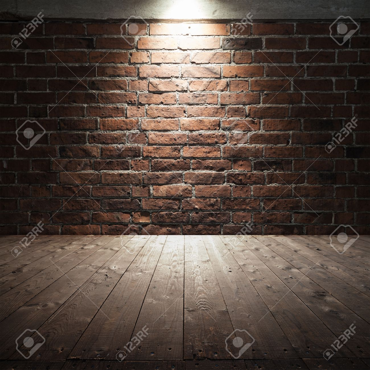 abstract dark interior background with wooden floor and red brick