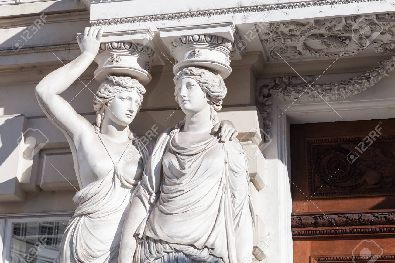 caryatid statues of two young women in form elegant columns stock