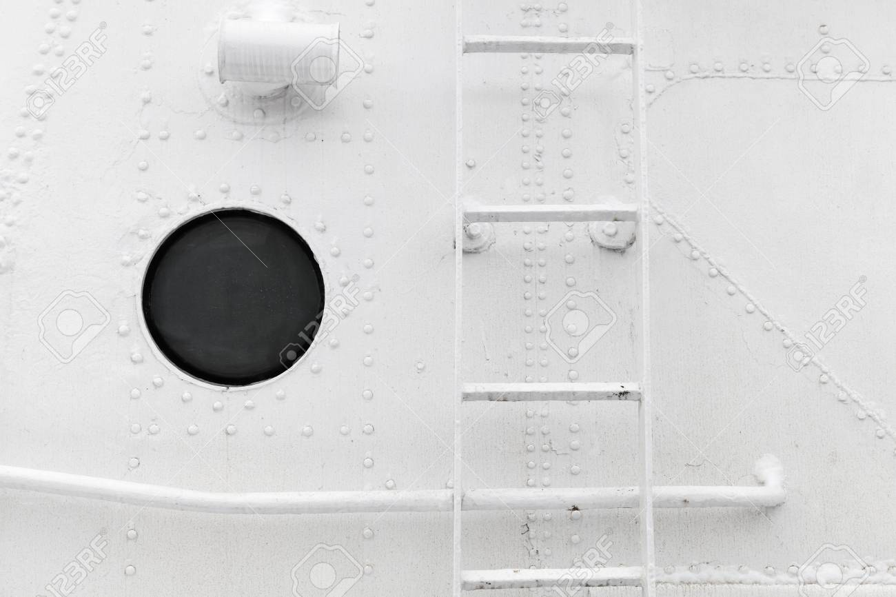 Old ship hull fragment with ladder and porthole, background photo
