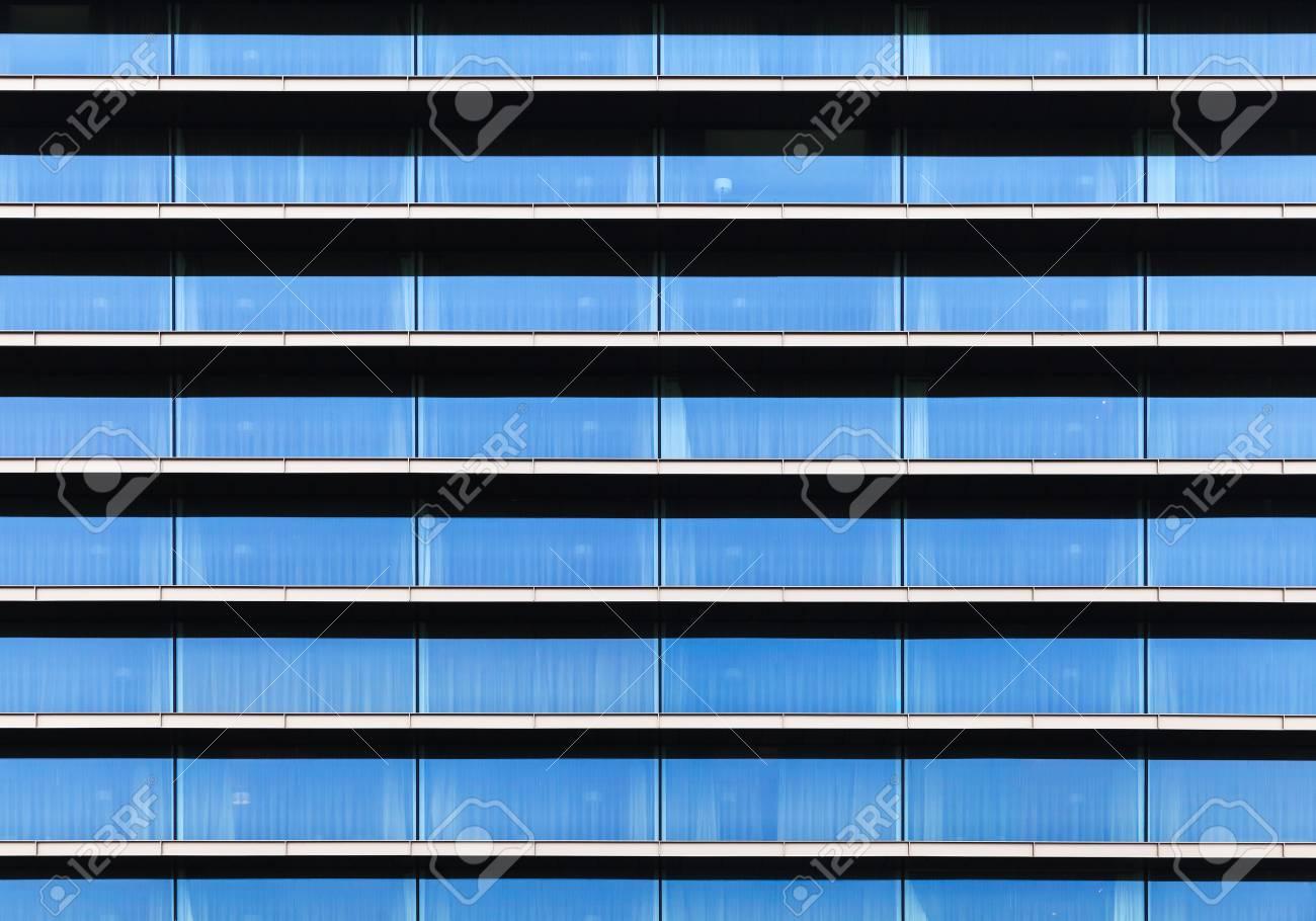 Modern Building Facade, Wall Made Of Blue Glass, Steel Frames ...