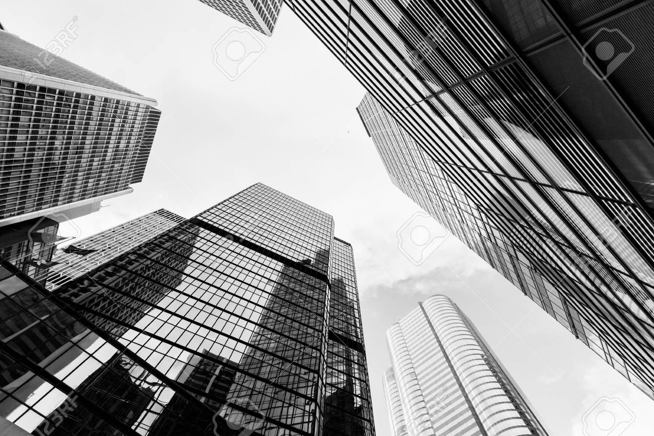 Stock photo urban skyline with skyscrapers high rise office buildings in city of hong kong black and white photo