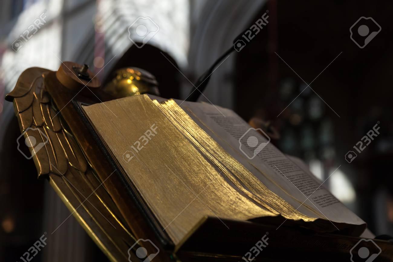Bath, United Kingdom - November 2, 2017: Open Bible with golden