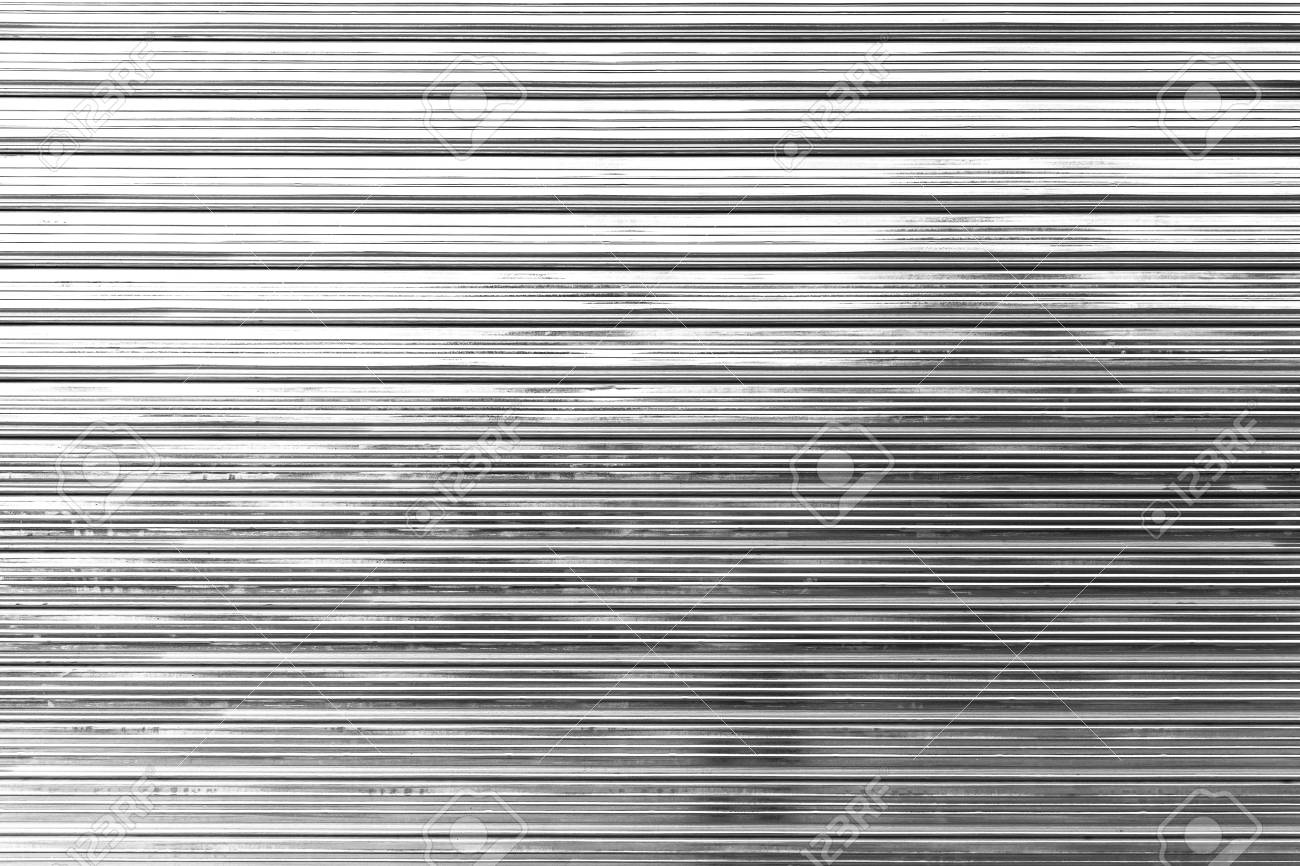 Shininy corrugated metal fence, standard industrial wall, background